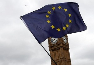 A European Union flag is waved in front of Big Ben outside Parliament after Britain's Prime Minister Theresa May triggered the process by which the United Kingdom will leave the European Union in London